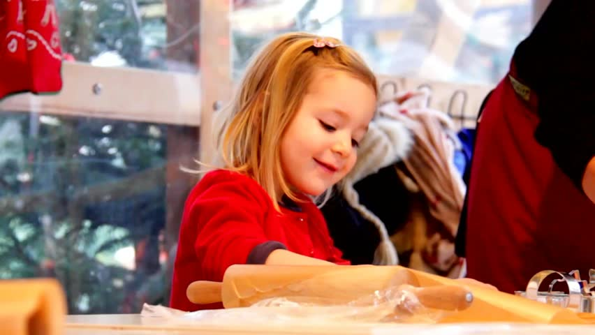 Little cute blond girl makes  cookies on Christmas market in Baden-Baden. Germany #8350246