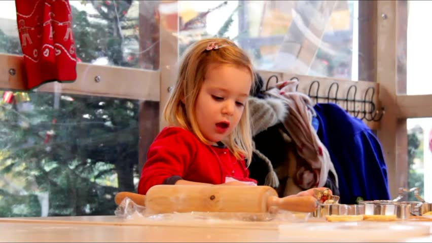 Little cute blond girl makes  cookies on Christmas market in Baden-Baden. Germany #8350264