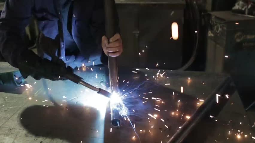 Man using welding in a metal fabricating workshop   Shutterstock HD Video #8371105
