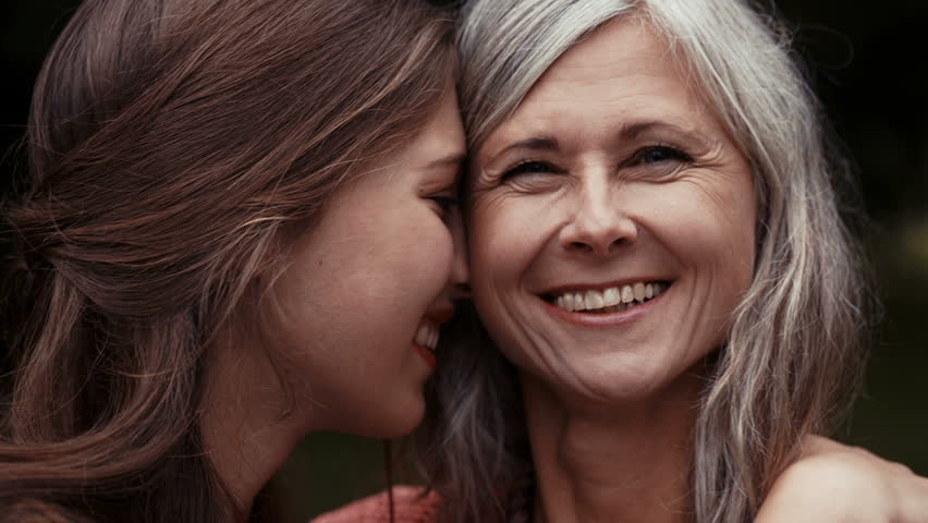 Close mother and daughter have a happy moment together