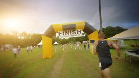 Slow motion Man completing a marathon. Crossing the finish line. First place. HD stock video clip