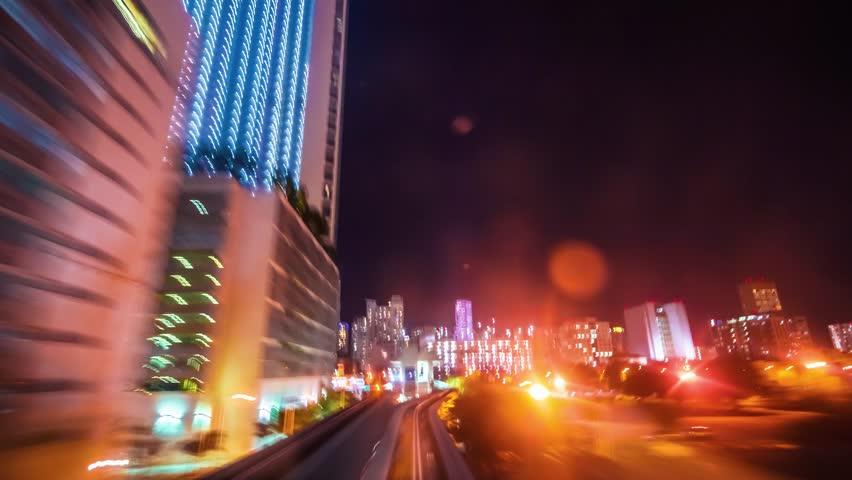 MIAMI, FLORIDA USA - DECEMBER 11, 2014: The automated Miami Metromover rides through Downtown Miami at night. Point of view time-lapse through downtown Miami.