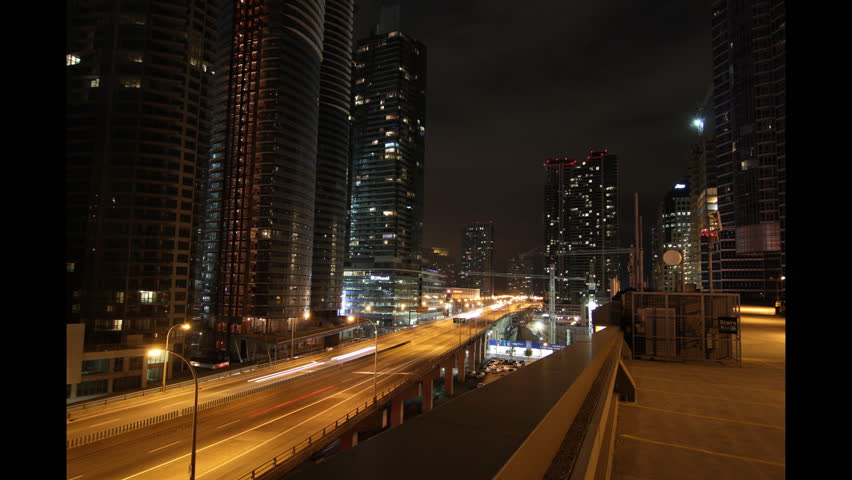 Toronto highway at night. Time lapse. Tilt up.