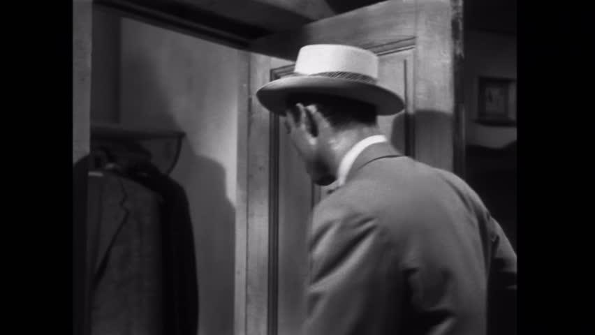 Man searching through jacket pockets in closet   Shutterstock HD Video #8488123