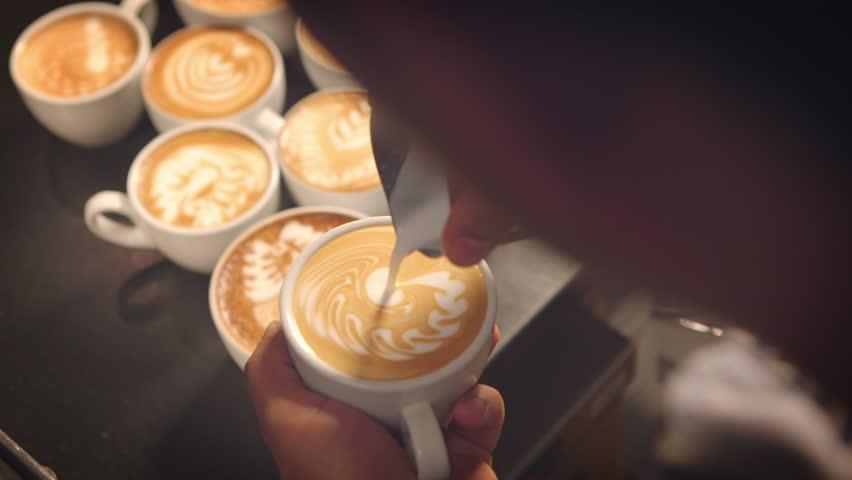 Barista prepares latte in take away cup #8494420
