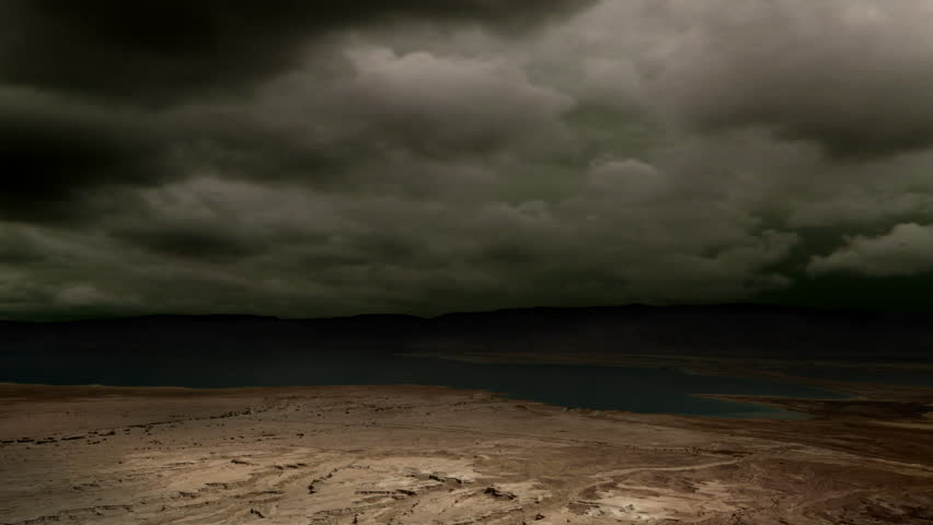 Looping ominous clouds and lightning over a desert plain