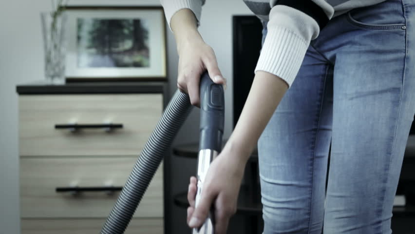 Tired woman working with vacuum cleaner at home, ineffective #8527486