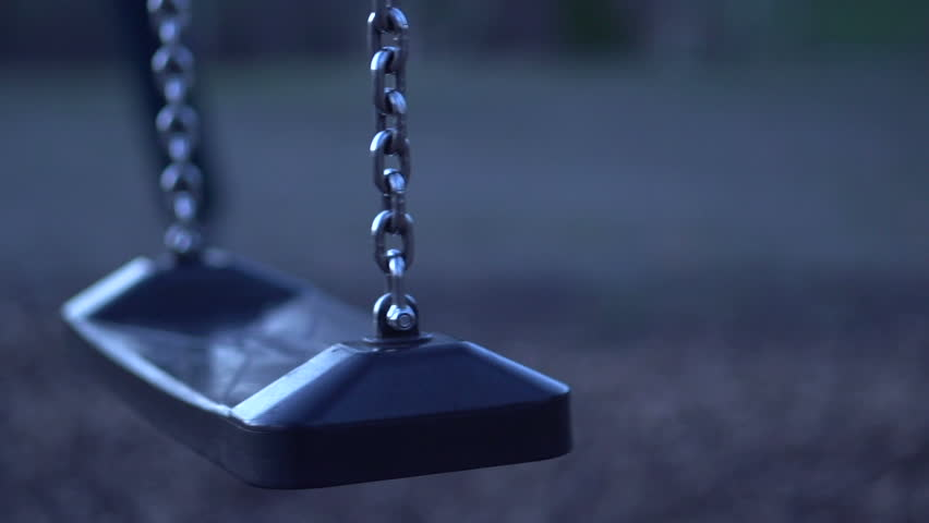 Playground swings at night with no one in park