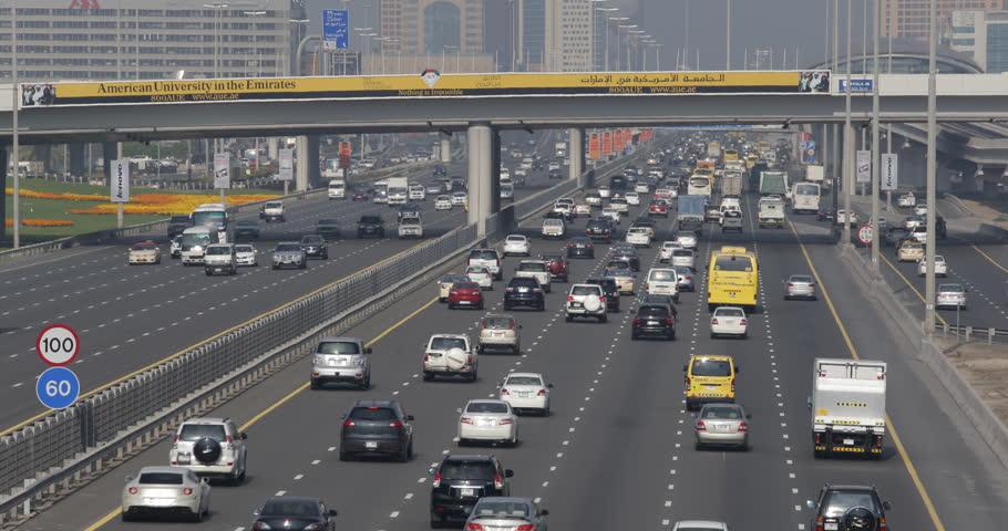 DUBAI, UAE - JANUARY 22, 2014 Sheikh Zayed Road Busy City Cars Pass Traffic Jam Rush Hour Crowded Highway Large Freeway ( Ultra High Definition, UltraHD, Ultra HD, UHD, 4K, 2160P, 4096x2160 ) #8538562