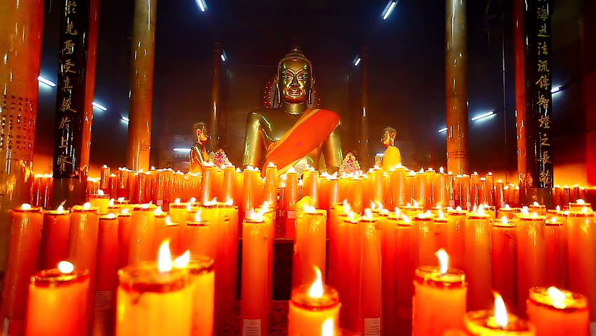 HD: Dolly, Buddha statuettes with candles in temple, 1920x1080,