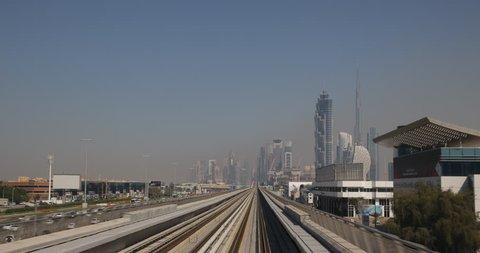 DUBAI, UAE - JANUARY 22, 2014 Dubai Skyline POV Metro Train Travel Trip Ride Skyscrapers Corporate Office ( Ultra High Definition, UltraHD, Ultra HD, UHD, 4K, 2160P, 4096x2160 )