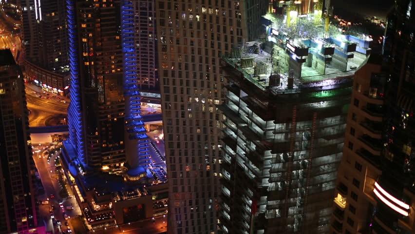 Aerial view new skyscraper construction zone in Dubai at night | Shutterstock HD Video #8563492