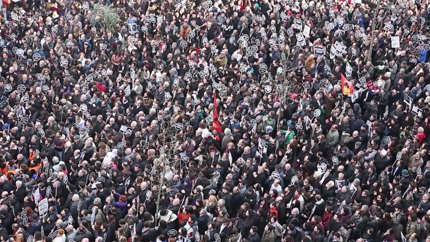 ISTANBUL - JANUARY 19: Thousands mark Hrant Dinks death 7 years on. Thousands of protesters walked from Taksim Square to Agos newspaper, on 19 January 2015 in Istanbul,Turkey   Shutterstock HD Video #8611126