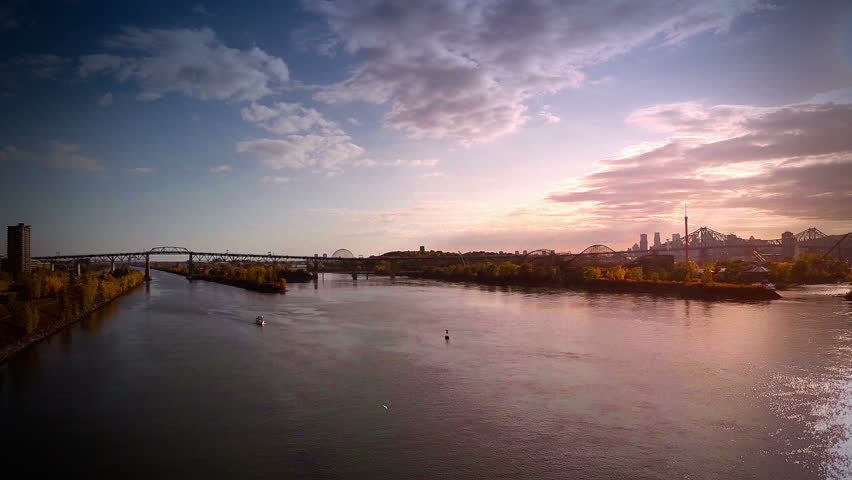 Aerial Footage of Montreal and Jacques-Cartier bridge city in Quebec, Canada during Autumn