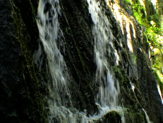 2 streams of water sliding down a rock face #86362