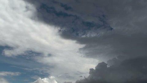 Time Lapse, Dark, stormy clouds creep across sky like a shroud. 1920x1080