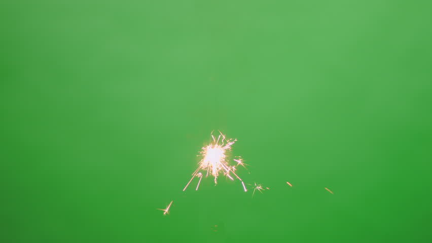 Centrally positioned burning sparkler floating in the air on green screen background | Shutterstock HD Video #8640019