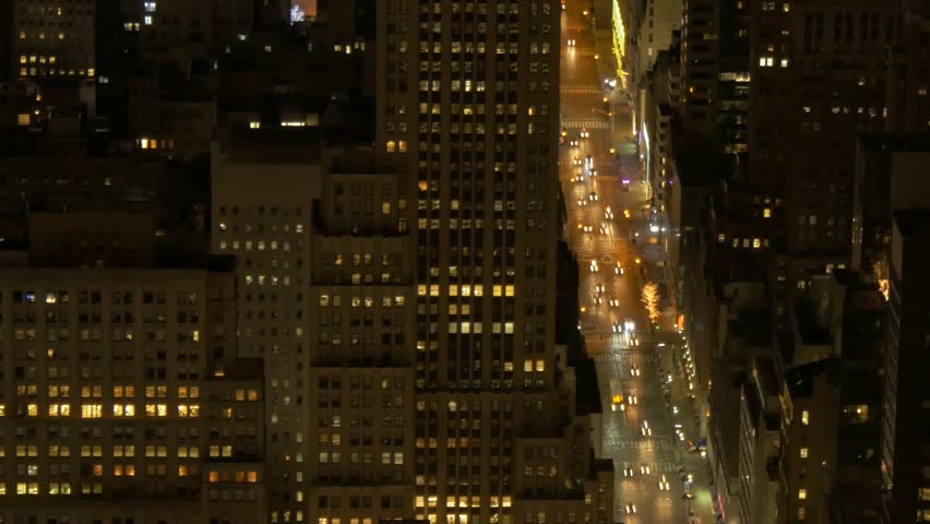 overlooking city metropolis at night. aerial view of new york city street traffic lights. #8648599