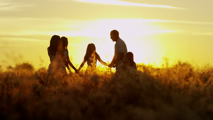 Social freedom young loving Caucasian family parents three sisters outdoor silhouette sunrise childhood innocence happiness together RED EPIC #8672635