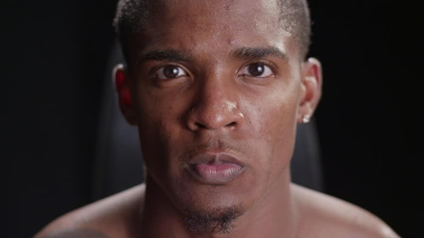 Muscular black man looking serious | Shutterstock HD Video #8675806