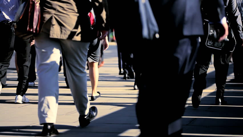 Legs of commuters walking to work in a busy city environment | Shutterstock HD Video #871210