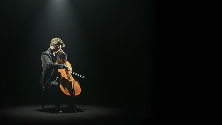 Cellist is tuning his cello alone on stage - HD video footage | Shutterstock HD Video #8730661