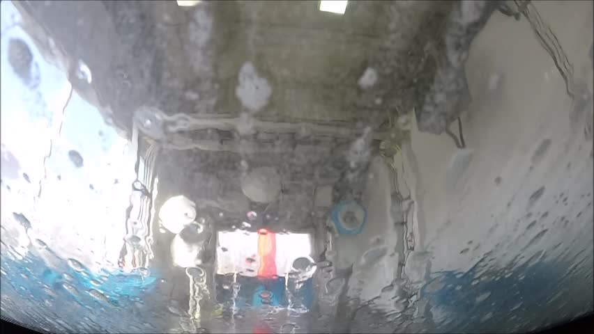Vehicle going through a car wash for cleaning #8746207