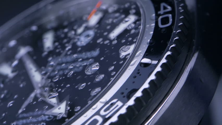 Wrist watch - slow motion / time passing slowly - beautiful macro shot with little drops of water on the glass | Shutterstock HD Video #8750068