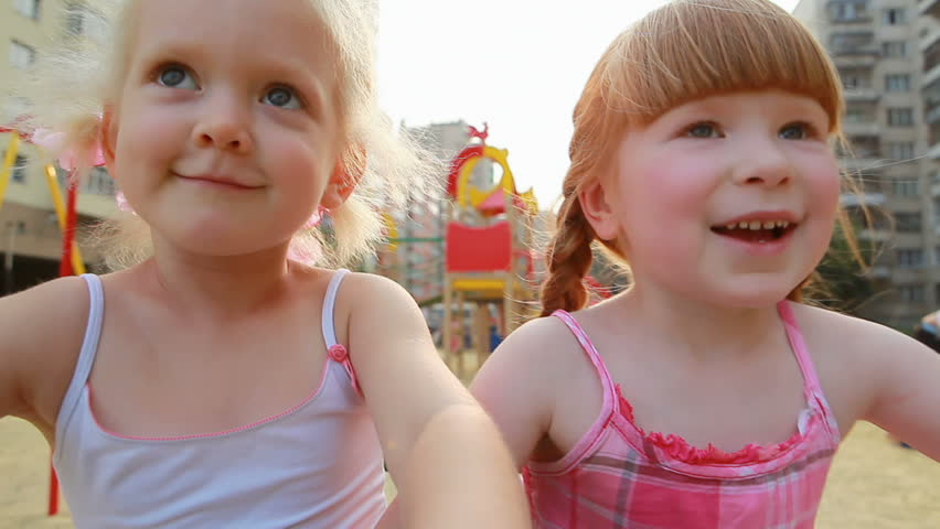 Two little girls on carousel
