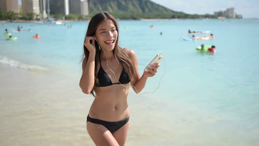 Music videos with girls in bikinis Music On Earphones From Smart Stock Footage Video 100 Royalty Free 8759809 Shutterstock