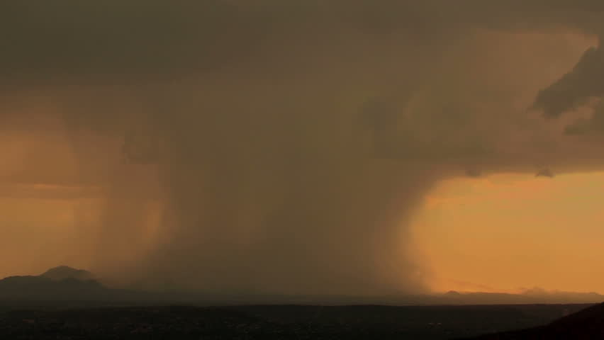 Fantastic time lapse of rain shafts dumping buckets of rain as they move across mountains at sunset. 1920x1080