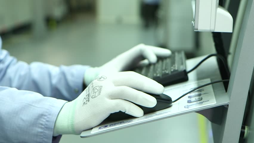 An Engineer controls the process. Techonology of Electronic Board Factory