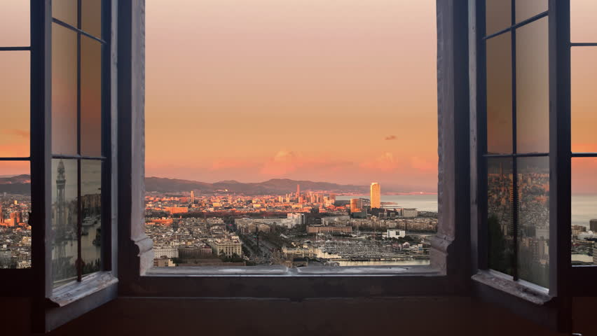 barcelona cityscape as seen from behind a window day to night timelapse at the sunset to night city lighting up panorama traffic rushing 4k