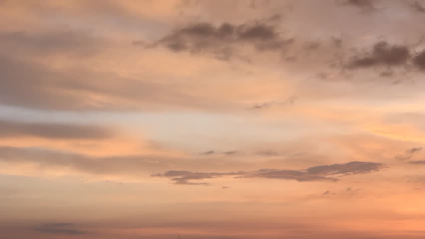 Warm colored clouds on twilight sky #8806903
