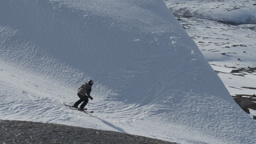 Skier doing a side flip while touching the snow hill | Shutterstock HD Video #8821708