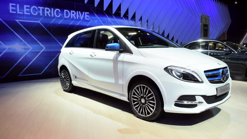 BRUSSELS, BELGIUM - JANUARY 15: White Mercedes Benz B-Class Electric Drive compact electric luxury car on display during the 2015 Brussels motor show.   Shutterstock HD Video #8828506