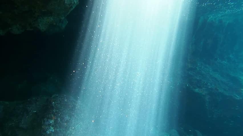 Underwater footage of sunbeams inside a cave | Shutterstock HD Video #8832007