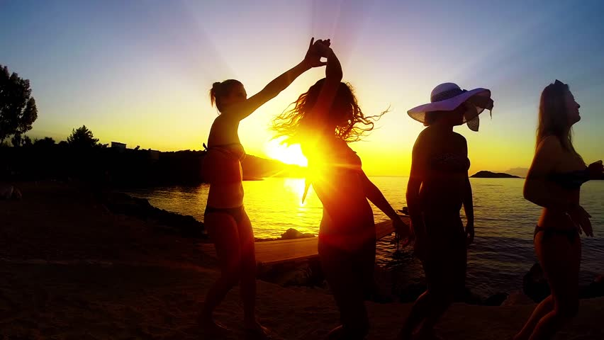 Group of Five Teenage Girls Dance and Celebrate On The Beach At Sunset, SLOW MOTION #8836630