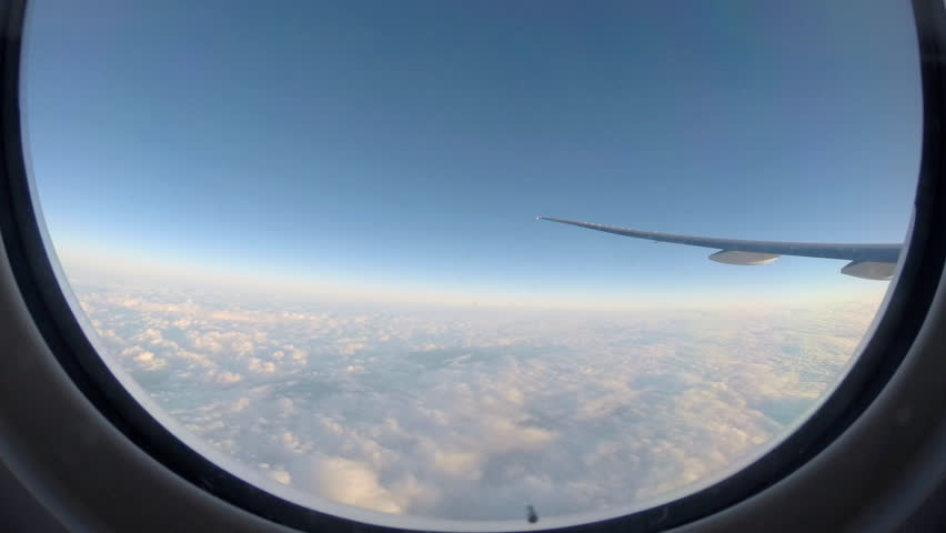 Timelapse 4K Hd Ultra Traveling by air. Wonderful view of the sky and clouds from above, as seen through an airplane window-Dan