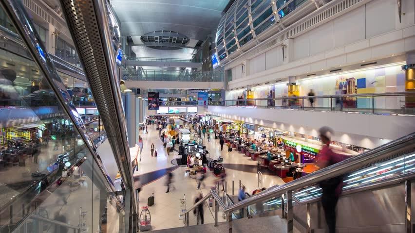 DUBAI, UAE - APRIL 1, 2014: People inside airport. Dubai International Airport is an international airport serving Dubai. It is a major airline hub in the Middle East. Time lapse movie.