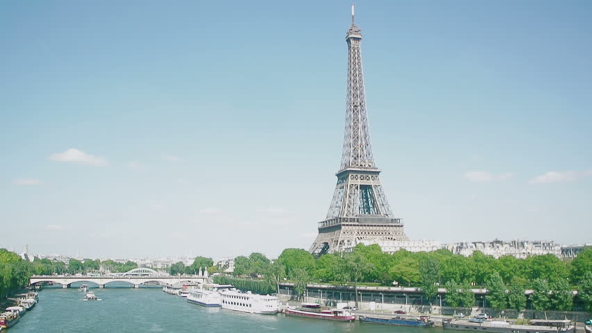 Eiffel Tower, Seine River, streets and homes with in heart of Paris seen by a drone  | Shutterstock HD Video #8882374
