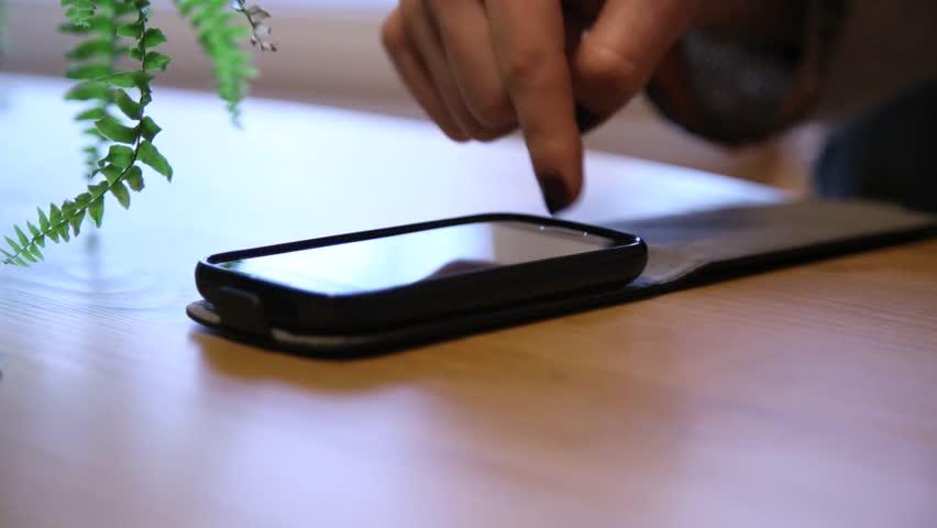 girl operating smartphone