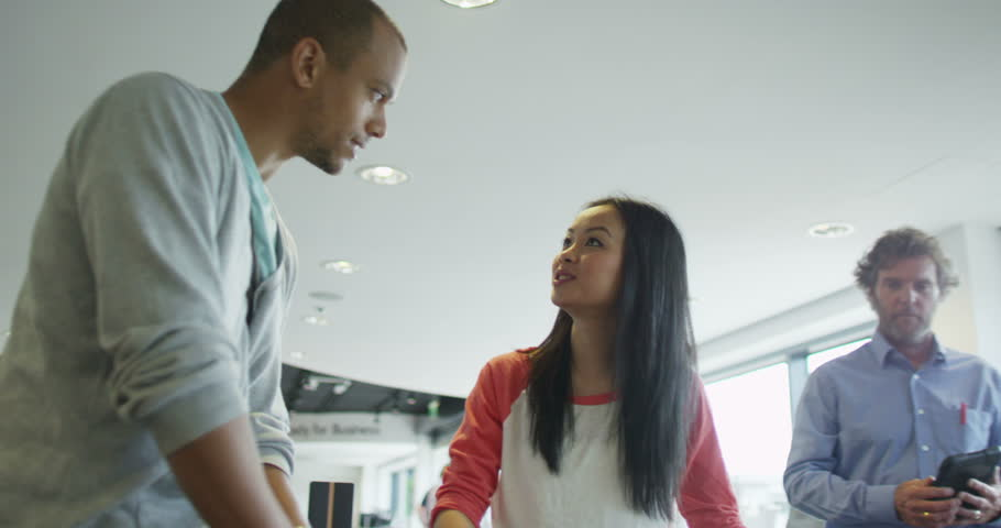 4K Couple shopping in consumer electronics store showroom | Shutterstock HD Video #8938111