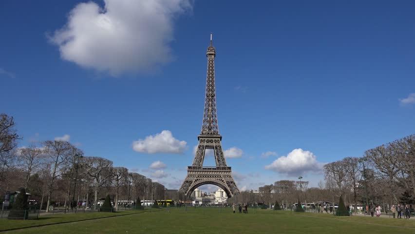 Eiffel Tower tilt down Champ de Mars - 60fps Tilt camera down Front view Eiffel Tower Champ de Mars  - 1080p | Shutterstock HD Video #8965660