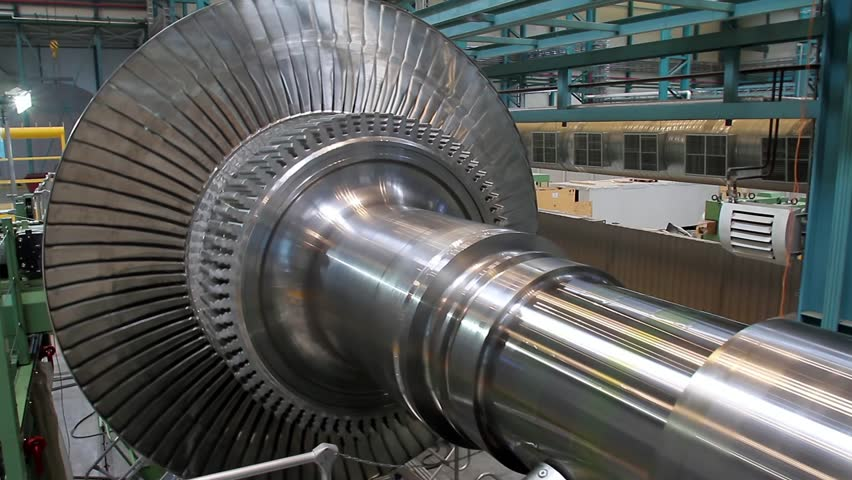 Rotation of a turbine at a plant producing power steam turbines  | Shutterstock HD Video #8973643