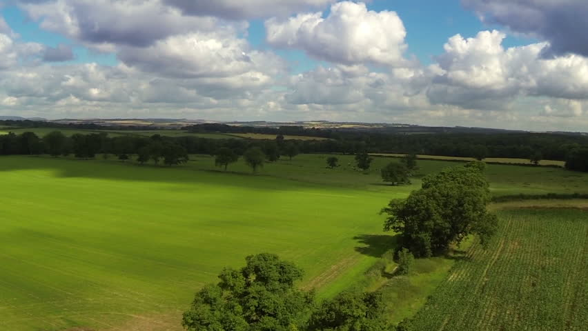 Aerial view of UK countryside and farmland in summer. High above green fields, crops and hedgerows on agricultural land. | Shutterstock HD Video #9005710