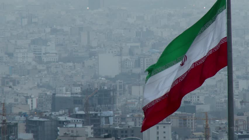 TEHRAN, IRAN JANUARY 2015: Iranian flag in the middle of Tehran city. | Shutterstock HD Video #9009763