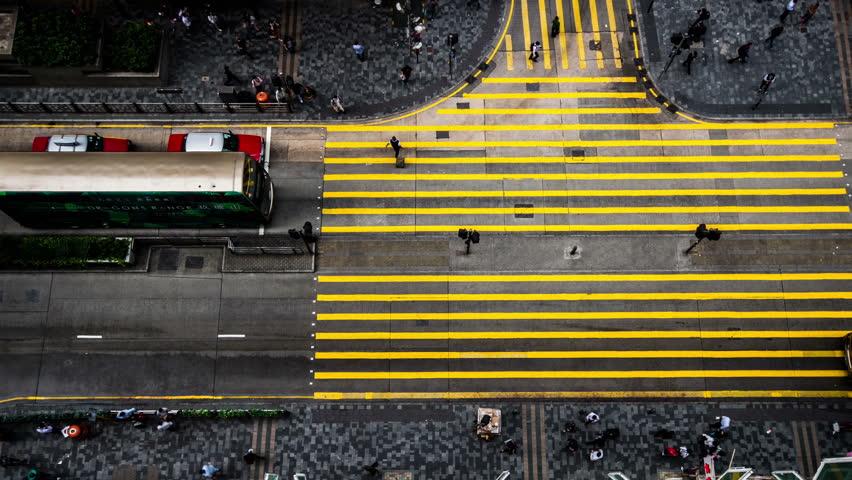 Hong Kong,China-Nov 12,2014: The bird view of the traffic and pedestrians in the downtown of Hong Kong,China
