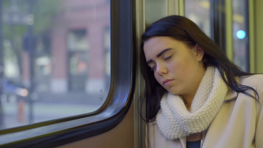 Mixed Race Teen Girl Sleeps On The Train On A Sunny Day In The City   Shutterstock HD Video #9020947