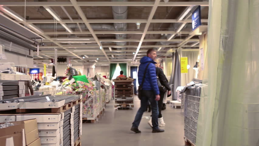 SAINT-PETERSBURG, RUSSIA - CIRCA JAN, 2015: Customers walk through the Ikea stands in showroom. Ikea multinational group is the world's largest furniture retailer. Russian store #9027103
